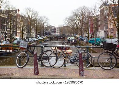 retro bike standing on a street of amsterdam, netherlands