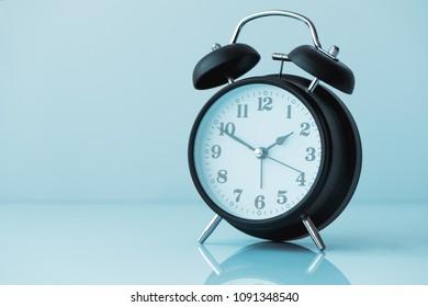 Retro black alarm clock with copy space