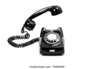 Retro black dial telephone isolated on white