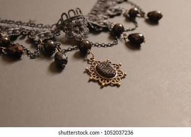 Retro black necklace.  Throwback choker on black background