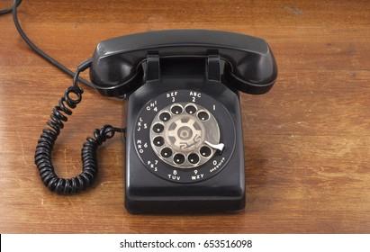 Retro black telephone on wood table