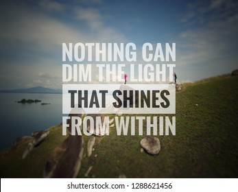 """Retro blurred landscape image with love inspirational quote """"Nothing can dim the light that shines from within"""""""