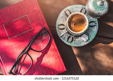 Retro books, glasses and türkish coffeee on table