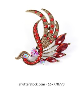 retro brooch with red gems isolated