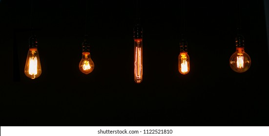 Retro bulbes of various shapes in the dark. Atmosphere of coziness and telp, great in a cafe.