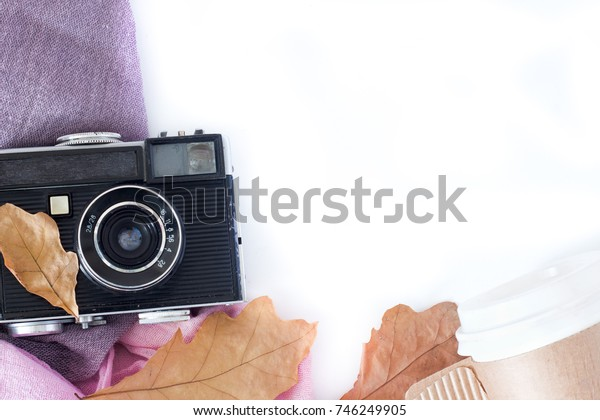 Retro camera and copy space with maple leaves in autumn border design - concept of remembrance and nostalgia in fall season. vintage rustic style.