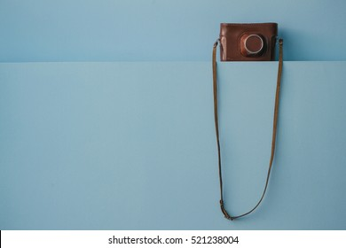 Retro camera on blue background. Place for text.