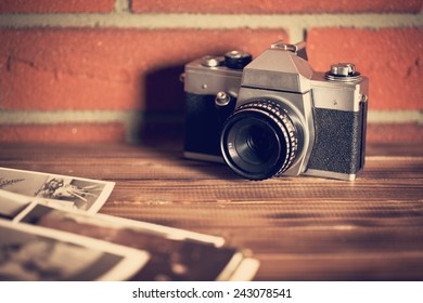 retro camera on wooden table