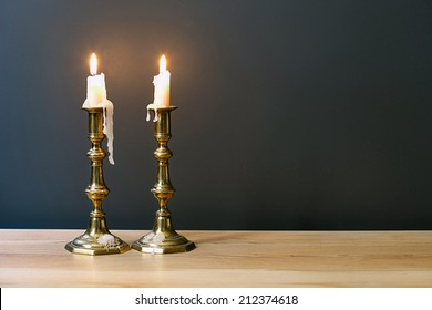 Retro Candelabra With Burning Candles In Minimalist Room Interior