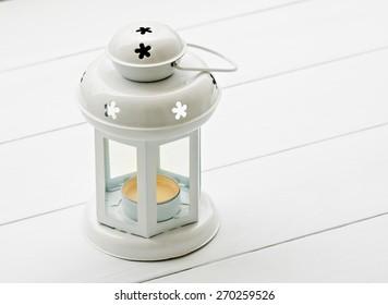 retro candle lantern lamp at white wood panel
