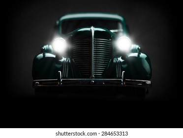 retro car with included lights on a dark background