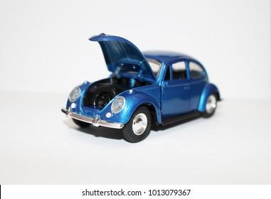 Retro car model on the white background. Toy model car Volkswagen Beetle. Vintage car model. Old retro beetle car. Baku -Azerbaijan 30 January 2018