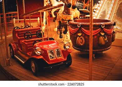 retro car on night carousel