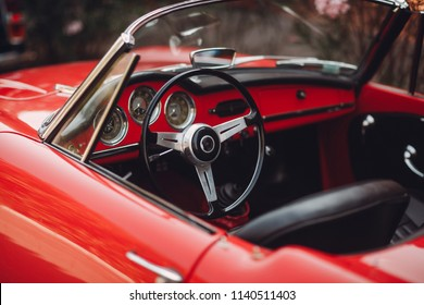 Retro car rally. French riviera. Nice - Cannes - Saint-Tropez. Red retro car concept.