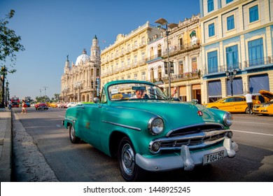 Retro car as taxi with tourists in Havana, Cuba. Captured near Gran Teatro de La Habana, El Capitolio and Paseo del Prado in spring 2019