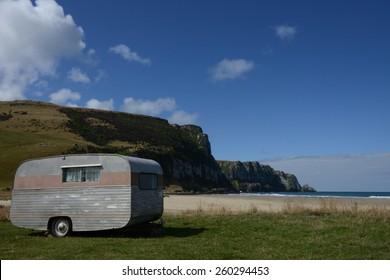 A retro caravan at the beach