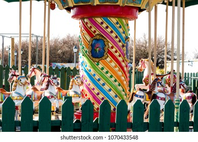 Retro carousel in empty closed fairground. Close up crop