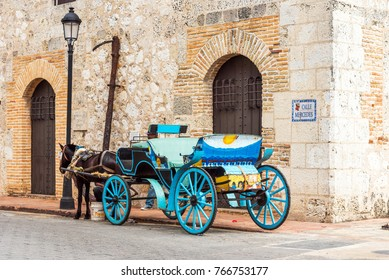 Retro carriage with a horse on a city street in Santo Domingo, Dominican Republic. Copy space for text