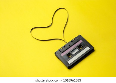 Retro cassette tape over yellow background. top view. copy space