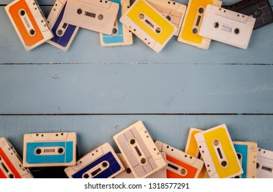 retro cassette tapes on wooden background
