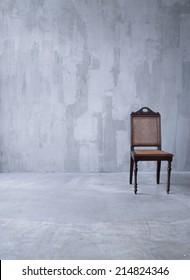 Retro chair in empty room.