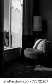 Retro Chair next to Window - Black and White