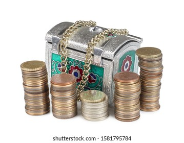 Retro chest and metal coin on white background