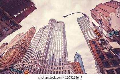 Retro cinematic style picture of skyscrapers at Lexington Avenue, New York City, USA.