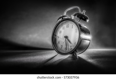 Retro clock against a dark background