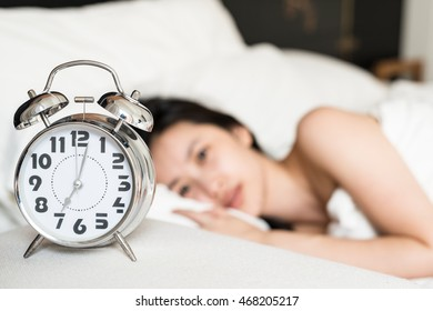 Retro clock in single girl bedroom.