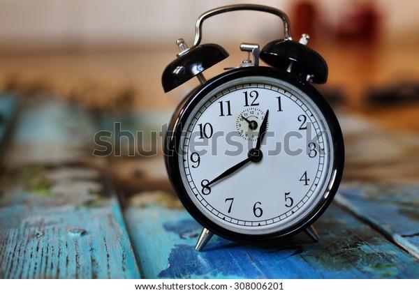 Retro clock, Vintage background with retro alarm clock on table, Vintage background with retro alarm clock on table