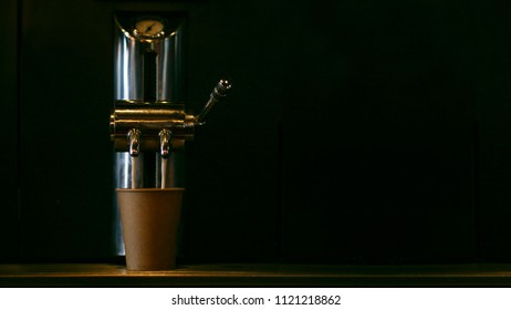 Retro coffee machine in a dark room, there is a process of cooking another hot drink that will cheer the sleepy worker.
