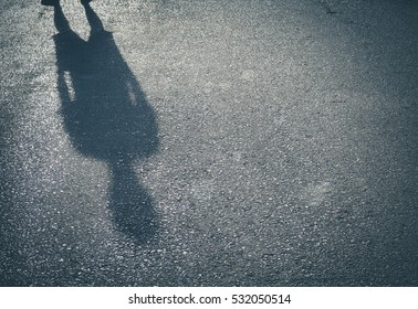 Retro color/ Shadow of a  men on street concrete background with place your text/ Abstract image