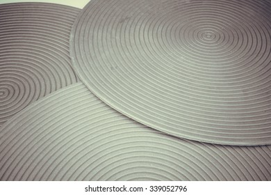 Retro color or retro styled round shaped place mat with circular texture. Slightly de-focused and close-up shot. Copy space.