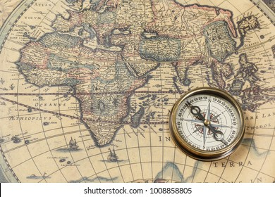 Retro compass with old map