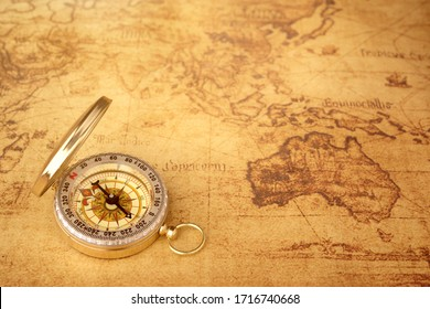 Retro compass with vintage map