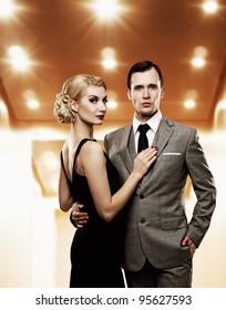 Retro couple in elevator.