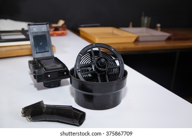 Retro darkroom devices for manufacturing old photos. Tanks for developing film on table in darkroom