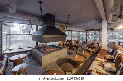 Retro designed restaurant interior with big fireplace