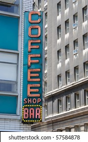 """Retro diner sign in the city saying """"coffee shop bar."""""""