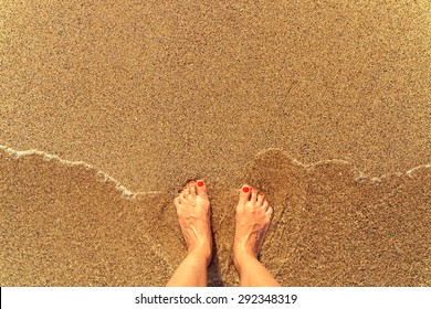 Retro Effect Of Sea Waves And Girl Feet On Summer Sand Beach
