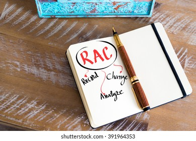 Retro effect and toned image of a fountain pen on a notebook. Business Acronym RAC as Record, Analyze, Change as business concept image