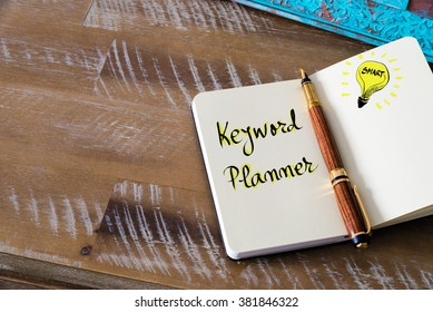 Retro effect and toned image of notebook next to a fountain pen. Business concept image with handwritten text KEYWORD PLANNER, copy space available, light bulb as smart idea