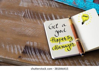 Retro effect and toned image of notebook next to a fountain pen. Business concept image with handwritten text GET A GOOD PROPERTY MANAGER, copy space available, light bulb as smart idea