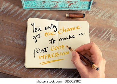 Retro effect and toned image of a woman hand writing a note with a fountain pen on a notebook. Handwritten text You Only Get One Chance To Make a First Good Impression as business concept image