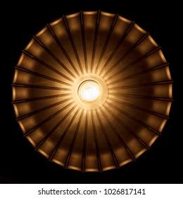 retro electric light bulb in yellow light