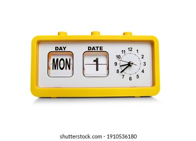 Retro electronic alarm clock and analog flip calendar. Retro design from 60s 70s home interior. Bright yellow color