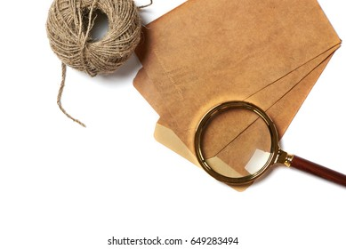 Retro envelope and magnifier isolated on white