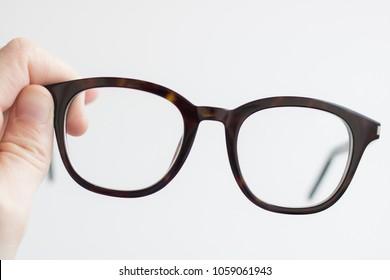 Retro eyeglasses on white background