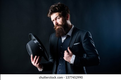 Retro fashion hat. Man with hat. Vintage fashion. Man well groomed bearded gentleman on dark background. Male fashion and menswear. Formal suit classic style outfit. Elegant and stylish hipster.